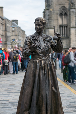 Edinburgh, Scotland - 23 August 2016 : Street Entertainer as Marie Curie at Royal Miles. In The Edinburgh Festival Fringe, which is hold every August on 23 August 2016 in Edinburgh, United Kingdom