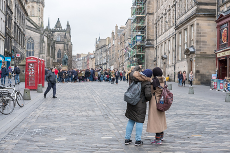 Edinburgh, United Kingdom. 17 February 2017 : People walking on The Royal Mile, a succession of streets forming the main thoroughfare of the Old Town of the city of Edinburgh in Scotland Editorial