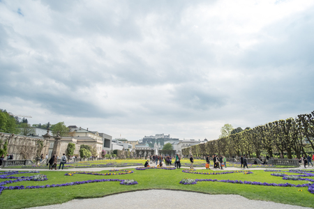 Salzburg, Austria - 14 April 2017 : People around The Mirabellgarten or Mirabell Gardens, the famous Baroque garden that featured in The Sound of Music.
