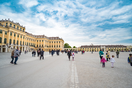 schoenbrunn: Vienna, Austria - 15 April 2017 : People walking around Schonbrunn Palace in Vienna. the Baroque palace which is a former imperial summer residence in Vienna.