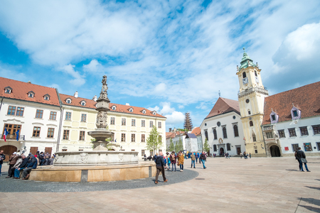slovak: Bratislava, Slovakia - 17 April 2017 : People walking around the main square in the old town of Bratislava