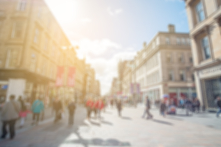 large group of business people: Blurred image of people walking on the street, with car, building in background. Buchanan Street in Glasgow, United Kingdom.