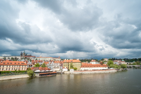 View of building along Vltava River, from Charles Bridge in Prague, Czech Republic.