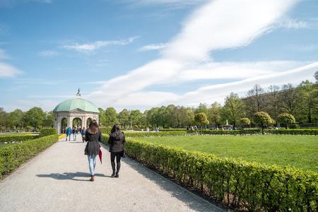 residenz: Munich, Germany - 21 April 2017 : People walking in Hofgarten, garden in the center of Munich which located between the Residenz and the Englischer Garten.