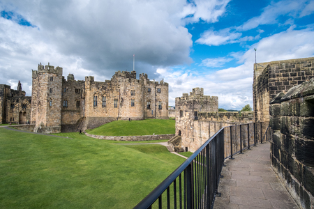 Alnwick Castle in Alnwick in the English county of Northumberland, United Kingdom. It is a location for films and programs. Stock Photo