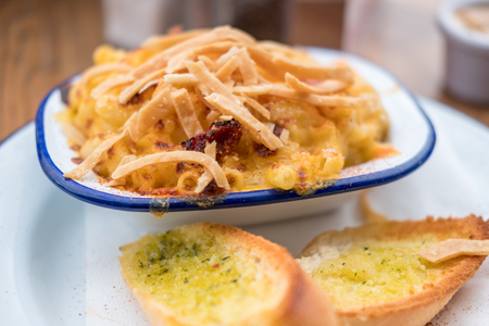 Mac and Cheese in a bowl with Garlic Bread