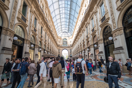 Milan, Italy - 16 September 2017: People walking around Galleria Vittorio Emanuele II, one of the world's oldest shopping malls.