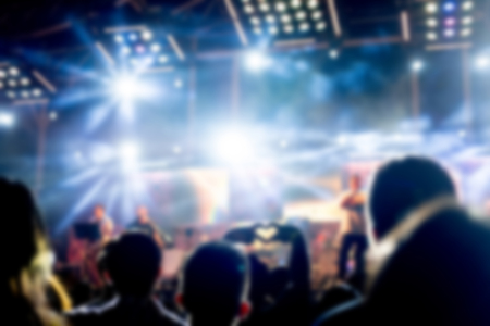 Blurred background : Bokeh lighting in outdoor concert with cheering audience Stock Photo