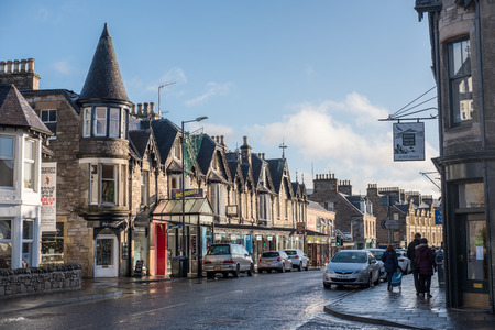 Pitlochry, United Kingdom - 10 November 2017: People walking on the main street in Pitlochry, a burgh in the county of Perthshire in Scotland, lying on the River Tummel