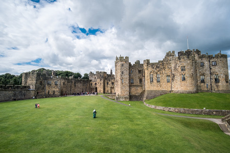 Alnwick, England - 5 August 2017: Tourist at Alnwick Castle in the English county of Northumberland, United Kingdom. It is a location for films and programs.