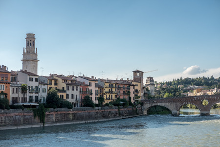View of Verona. Ponte Pietra, once known as the Pons Marmoreus. It is the Roman arch bridge crossing Adige River Stock Photo - 97661911