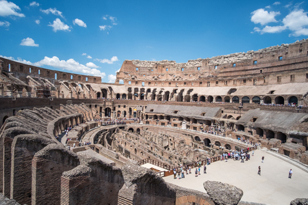 Rome, Italy. 16 May 2017 : Tourists visiting Colosseum an oval amphitheatre in the center of the city of Rome. It is the famous landmark built of concrete and sand.
