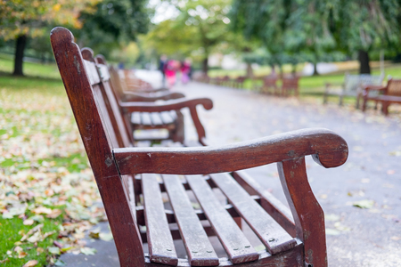 Benches along the way in Princes Street Gardens, the public space in city center of Edinburgh.
