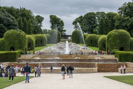 Alnwick, England - 5 August 2017: People walking around The Alnwick Garden, a complex of formal gardens adjacent to Alnwick Castle in the town of Alnwick, Northumberland, England Editorial