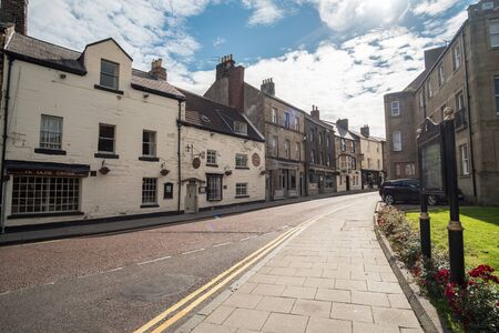 Alnwick, England - 5 August 2017: View of the building in the city of Alnwick, a market town in north Northumberland, England