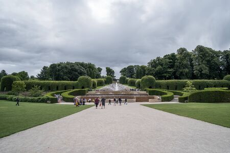 Alnwick, England - 5 August 2017: People walking around The Alnwick Garden, a complex of formal gardens adjacent to Alnwick Castle in the town of Alnwick, Northumberland, England