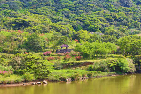 Beautiful mountain scenery with pavilion and lake