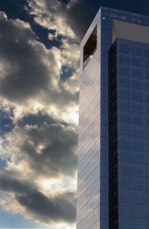 A modern medical skycraper surround by dark clouds