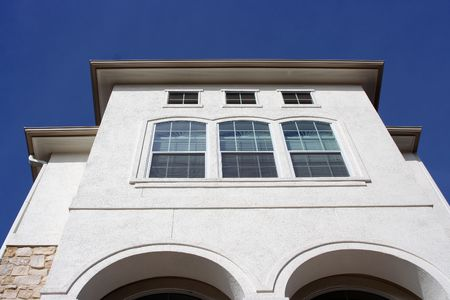 A modern stucco house reaching into the blue sky Stock Photo - 2597166