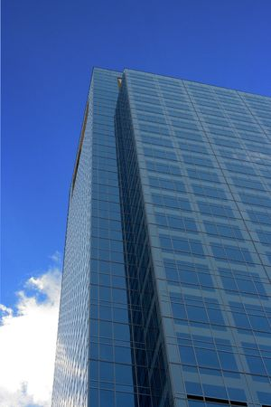 A modern medical skycraper reaching into the blue sky photo