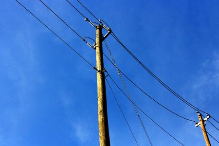 telegraphs: Telephone Poles with a blue sky background Stock Photo
