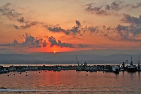 A sunsetting over a local city harbor