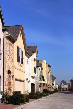 An urban neighborhood where the homes are close together Stock Photo