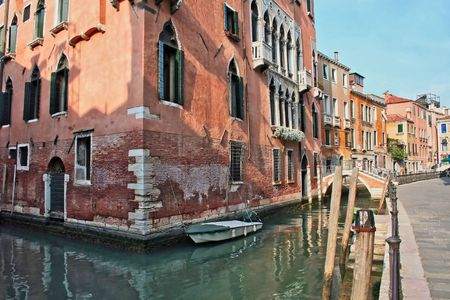 A home in venice on the water with a boat outside the door Stock Photo
