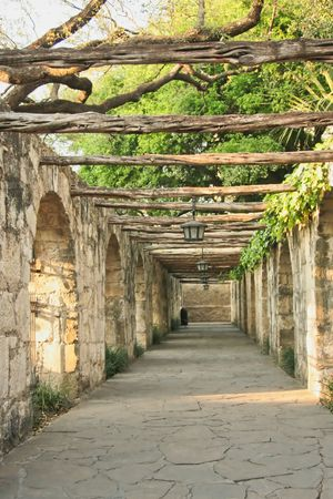 A timber lined colonnade at the Alamo in San Antonio Texas