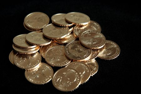 A single pile of gold U.S. one dollar coins