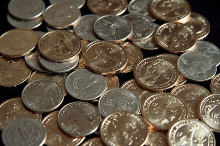 A single pile of gold U.S. one dollar coins and quarters photo