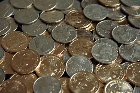 A single pile of gold U.S. one dollar coins and quarters Stok Fotoğraf