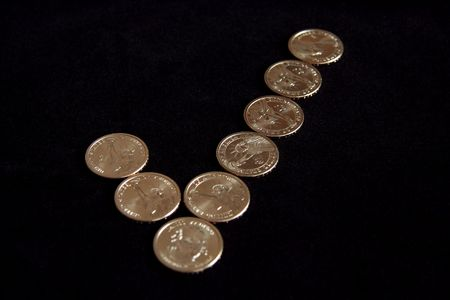 A checkmark made out of dollar coins photo