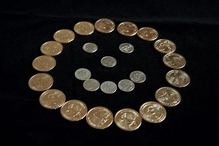A smiley face made out of dollar coins photo