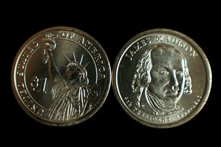 A one dollar James Madison and statue of liberty US coin