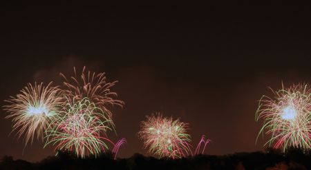 A firework display that was shot off in three locations Stock Photo - 3392650