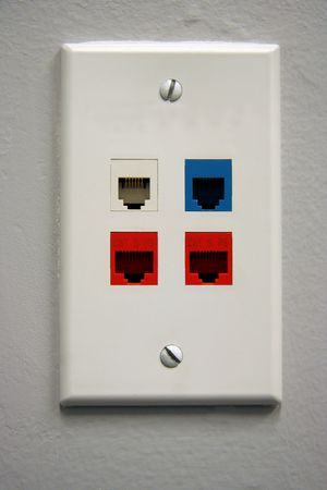 A white telephone data outlet with 4 plugs for US data