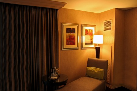 A hotel room armchair and table with a lamp on Stock Photo - 4154776