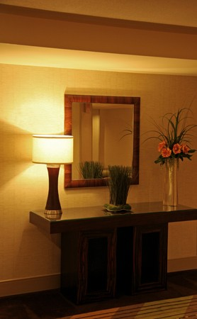 A modern end table arrangement with mirror and lamp Stock Photo