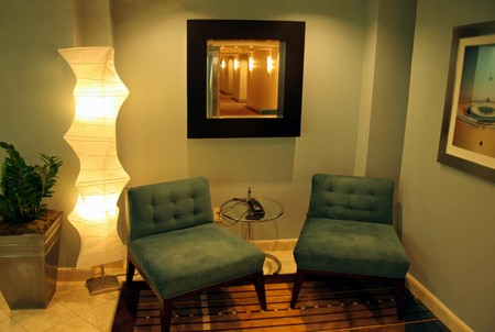 Two blue chairs in a modern seating area