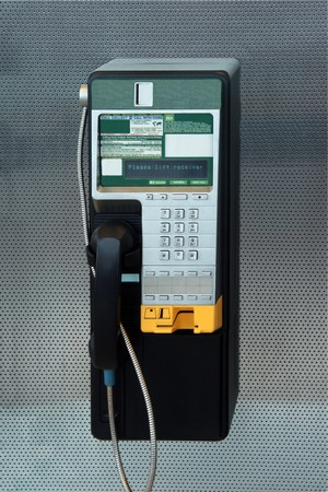A modern payphone on a silver background Stock Photo