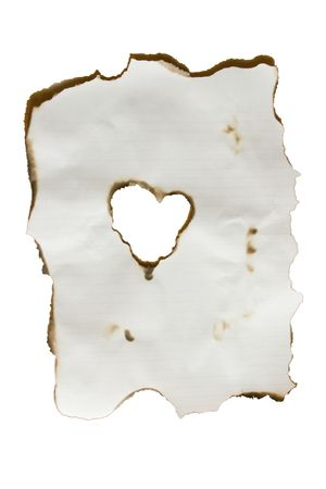 An isolation of a burned piece of paper with a heart at the center photo