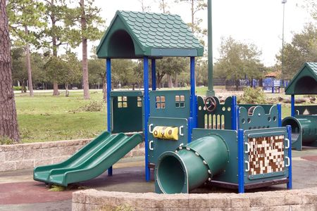 A playground shaped as a house with slides photo