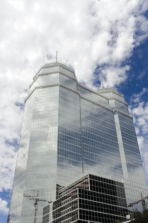 spires: A large glass building with two white spires Stock Photo