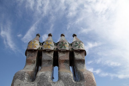 clustered: Chimney smoke stacks clustered together with tiles coving them Stock Photo