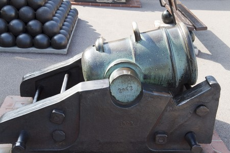 An old bronze cannon that has tarnished