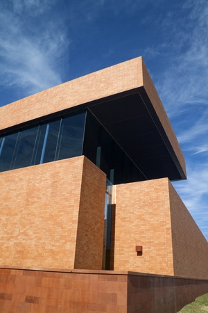 A modern brick building with a blue sky photo