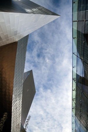 A view of the sky between two modern buildings