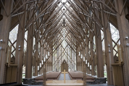 The insides of a wooden and glass church from the alter