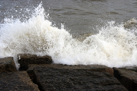 Ocean waves crashing onto some rocks Stock Photo - 13111968